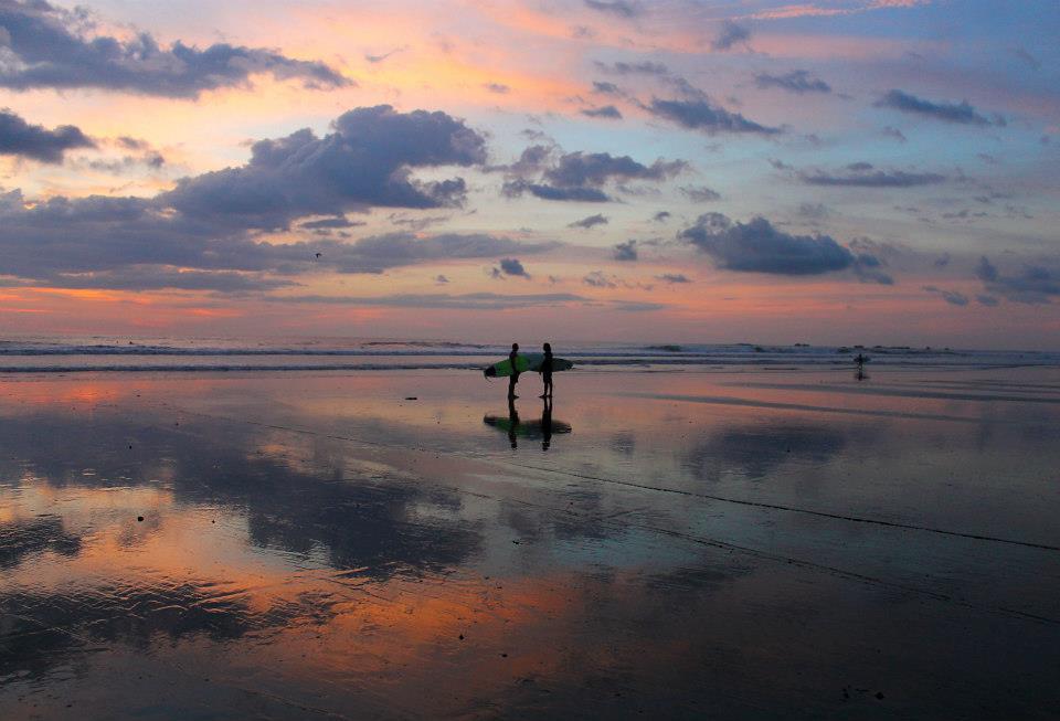 Surfers Meeting on Beach
